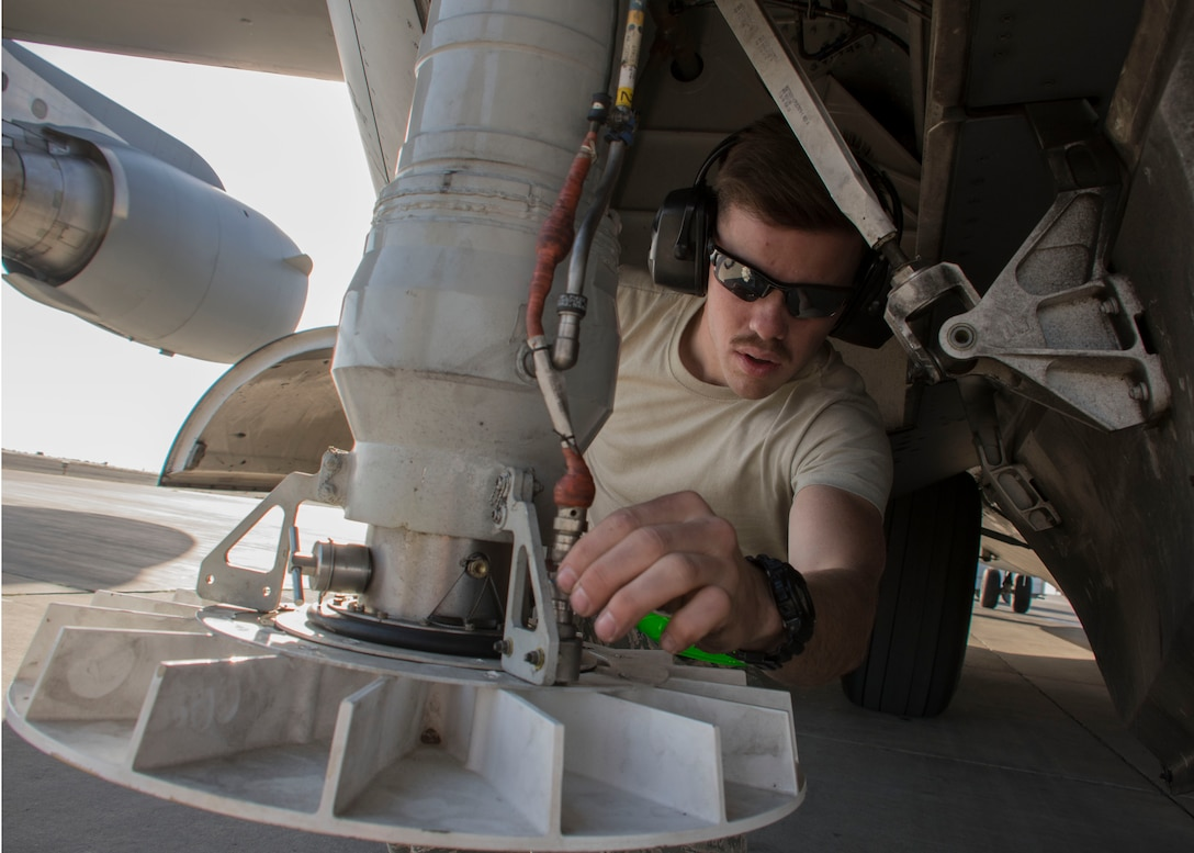 Airman 1st Class Nathan Travis, a 5th Expeditionary Air Mobility Squadron aircraft electrical and environment systems journeyman, inspects wiring on the stabilizer strut of a C-17 Globemaster III at an undisclosed location in Southwest Asia Jan. 13, 2017. Crew chiefs from the small squadron rely on specialists such as electricians to help out with inspections. (U.S. Air Force photo/Senior Airman Andrew Park)