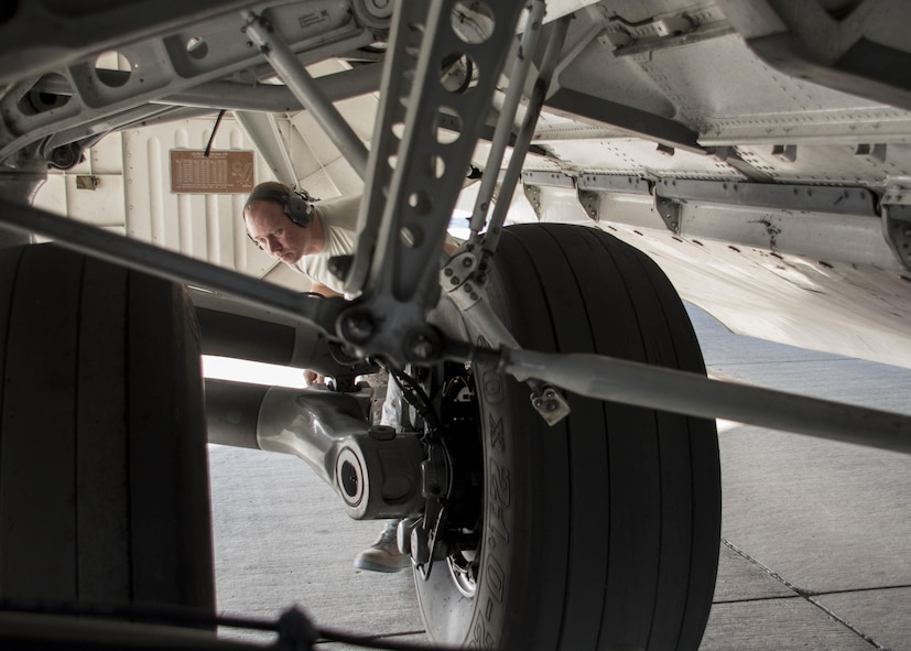 Tech. Sgt. Brian Maggard, a 5th Expeditionary Air Mobility Squadron aerospace maintenance craftsman, inspects the tires of a C-17 Globemaster III during a post-flight inspection at an undisclosed location in Southwest Asia Jan. 13, 2017. Tires usually wear out quickly on Globemasters as their missions often require landing on gravel or dirt runways in austere locations to deliver supplies and personnel. (U.S. Air Force photo/Senior Airman Andrew Park)