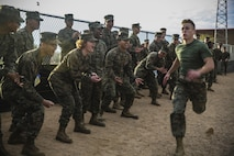 """Marines with Marine Air Control Squadron 1 cheer on a fellow Marine during the o-course relay as part of the """"Super Squadron"""" competition at the Memorial Sports Complex aboard Marine Corps Air Station Yuma, Ariz., Friday, Jan. 13, 2017."""