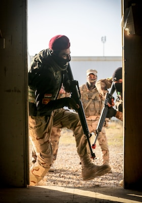 Iraqi soldiers from 7th Iraqi Army Division assault through a door during assault movement training at Al Asad Air Base, Iraq,  Jan. 13, 2017. Training at building partner capacity sites is an integral part of Combined Joint Task Force – Operation Inherent Resolve's effort to train Iraqi security forces personnel to defeat ISIL. CJTF-OIR is the global Coalition to defeat ISIL in Iraq and Syria. (U.S. Army photo by Sgt. Lisa Soy)