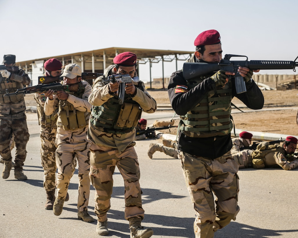 Iraqi soldiers from 7th Iraqi Army Division practice bounding during assault movement training at Al Asad Air Base, Iraq, Jan. 13, 2017. Training at building partner capacity sites is an integral part of Combined Joint Task Force – Operation Inherent Resolve's effort to train Iraqi security forces personnel to defeat ISIL. CJTF-OIR is the global Coalition to defeat ISIL in Iraq and Syria. (U.S. Army photo by Sgt. Lisa Soy)