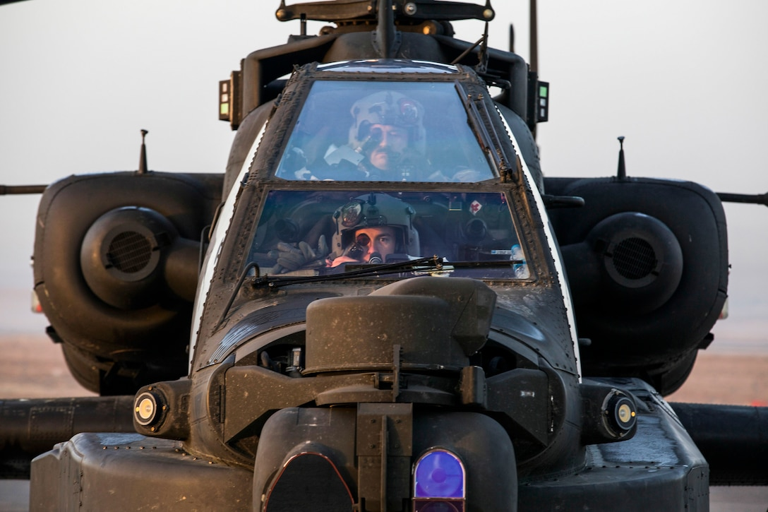 U.S. Soldiers from Bravo Troop, 4th Squadron, 6th Calvary Regiment, Task Force Saber conduct pre-flight on an AH 64E Apache helicopter at Camp Erbil, Iraq, Jan. 10, 2017. U.S. Army Aviation are enabling partnered forces to defeat ISIL by providing air support on the battlefield. Combined Joint Task Force – Operation Inherent Resolve is the global Coalition to destroy ISIL Combined Joint Task Force - Operation Inherent Resolve is the global Coalition to defeat ISIL in Iraqi and Syria. (U.S. Army photo by Spc. Craig Jensen)