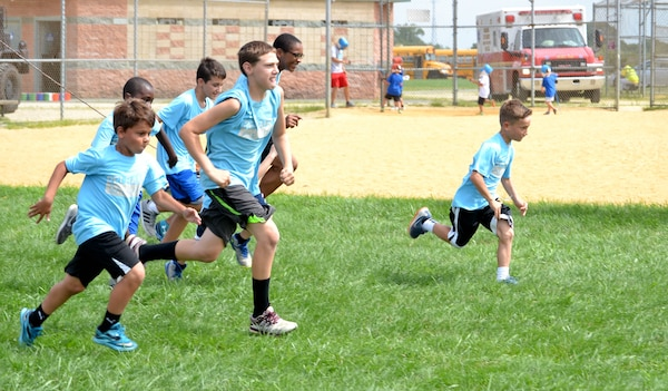 Local children complete seven obstacle courses during the Philly Play Summer Challenge August 10, 2016 in Northeast Philadelphia. DLA Troop Support active duty personnel were among nearly 40 military personnel to help more than 2,000 local children during the event, aimed at encouraging teamwork and physical fitness.