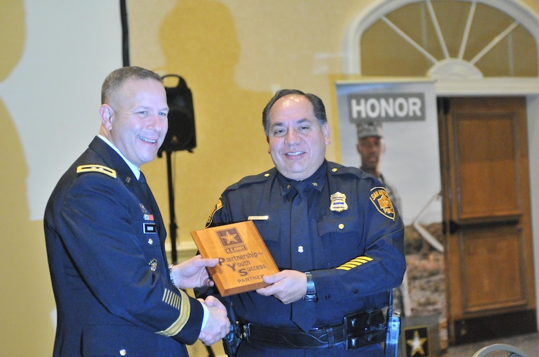 Maj. Gen. Jeffrey Snow (left), commanding general, U.S. Army Recruiting Command and Jimmy Reyes (right), deputy chief, San Antonio Police Department, celebrate the Partnership for Youth Success (PaYS) program signing agreement, Jan. 6, Marriott Plaza Hotel, San Antonio.
