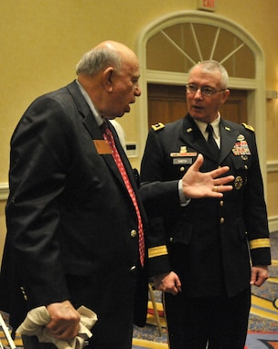 Olin Brewster (left), U.S. Army Reserve ambassador, 63rd Regional Support Command, talks with Maj. Gen. Michael Smith, deputy chief, U.S. Army Reserve about the benefits of the Partnership for Youth Success (PaYS) program agreement, signed Jan. 6, Marriot Plaza Hotel, San Antonio.