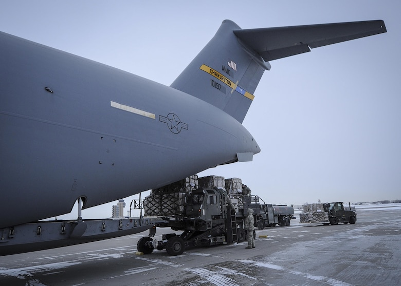 934th Airlift Wing Airmen load humanitarian cargo onto a Joint Base Charleston C-17 Globemaster III at Minneapolis-St Paul Air Reserve Station, Minnesota Jan. 13, 2017.  The 315th AW aircrew delivered the cargo to Ramstein Air Base, Germany where is will await delivery into northern Iraq to Kurdish refugees. (U.S. Air Force photo by Senior Airman Tom Brading)