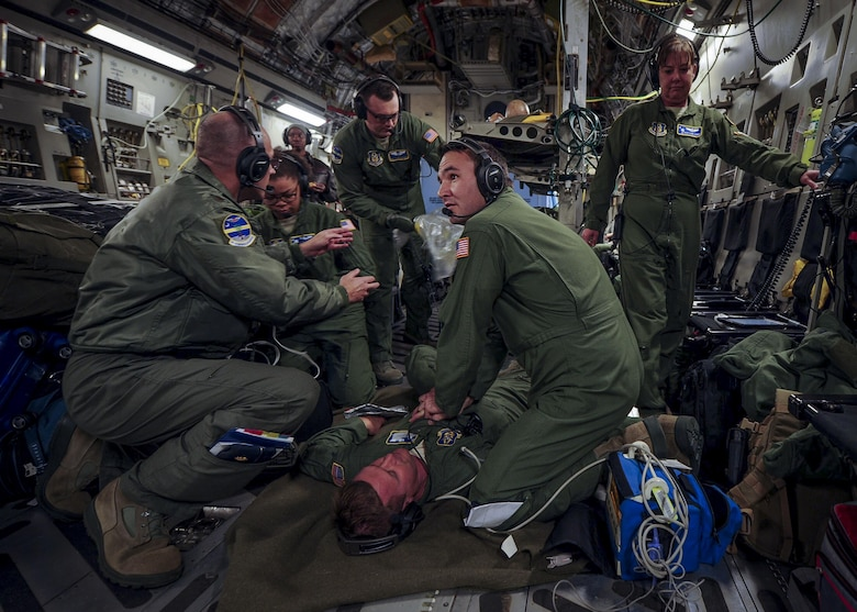 Senior Airman Josh Lykins, 315th Aeromedical Evacuation Squadron medical technician, provides CPR during a medical training exercise January 13, 2017, while on board a C-17 Globemaster III bound for Ramstein Air Base, Germany. Airmen from the 315th AES are able to conduct medical training, while in conjunction with real-world operations. (U.S. Air Force photo by Senior Airman Tom Brading)