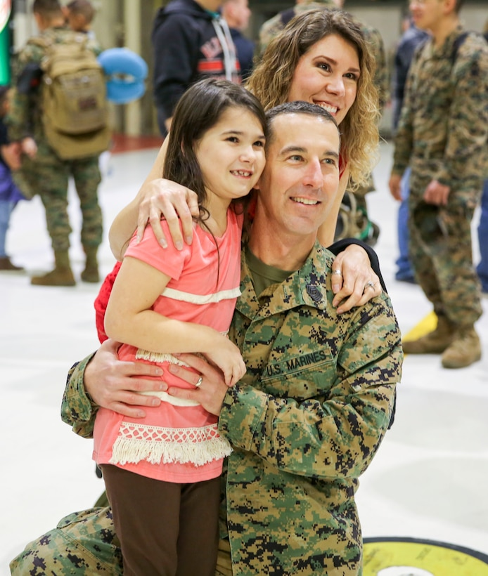 Sgt. Maj. Brandon Eckardt and his family are reunited aboard Marine Corps Air Station Cherry Point, Jan. 16, 2017 after a deployment with the 31st Marine Expeditionary Unit. Eckardt and fellow Marines assigned to Marine Attack Squadron 54, Marine Aircraft Group 14, 2nd Marine Aircraft Wing returned to MCAS Cherry Point for the first time since being deployed in June, 2016. Eckardt is the sergeant major of VMA-542. (U.S. Marine Corps photo by Lance Cpl. Cody Lemons/Released)