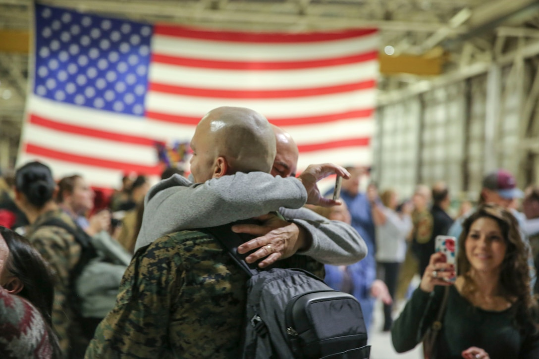 Sgt. Nicholas Christopoulas is reunited with his family aboard Marine Corps Air Station Cherry Point, Jan. 17, 2017. Marines assigned to Marine Attack Squadron 542, Marine Aircraft Group 14, 2nd Marine Aircraft Wing were deployed with the 31st Marine Expeditionary Unit since June, 2016. Christopoulas is a fixed wing safety equipment mechanic assigned to VMA-542. (U.S. Marine Corps photo by Lance Cpl. Cody Lemons/Released)