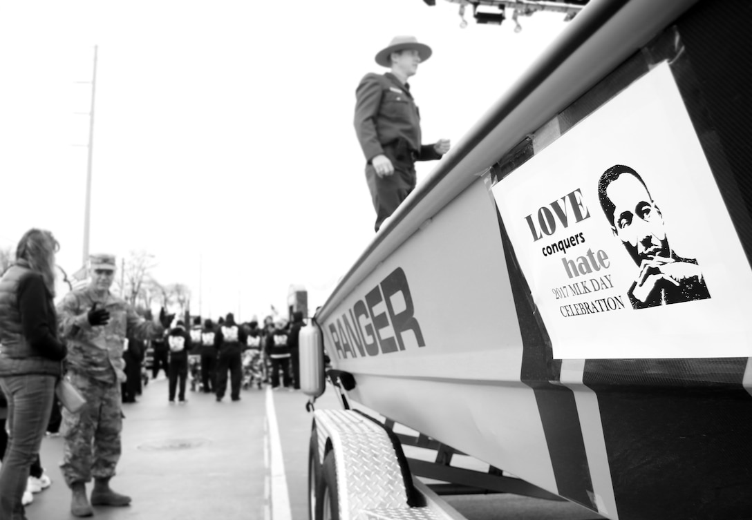 """Parade theme, """"Love Conquers Hate,"""" is displayed on the side of a Tulsa District, U.S. Army Corps of Engineers, boat in preparation for the 38th annual Martin Luther King Jr. Commemorative Parade in Tulsa, Okla., January 16, 2017.   Personnel from the Tulsa District have been participating in the city of Tulsa's MLK Day parade for more than 20 years. (U.S. Army Corps of Engineers photo by Preston Chasteen/Released)"""