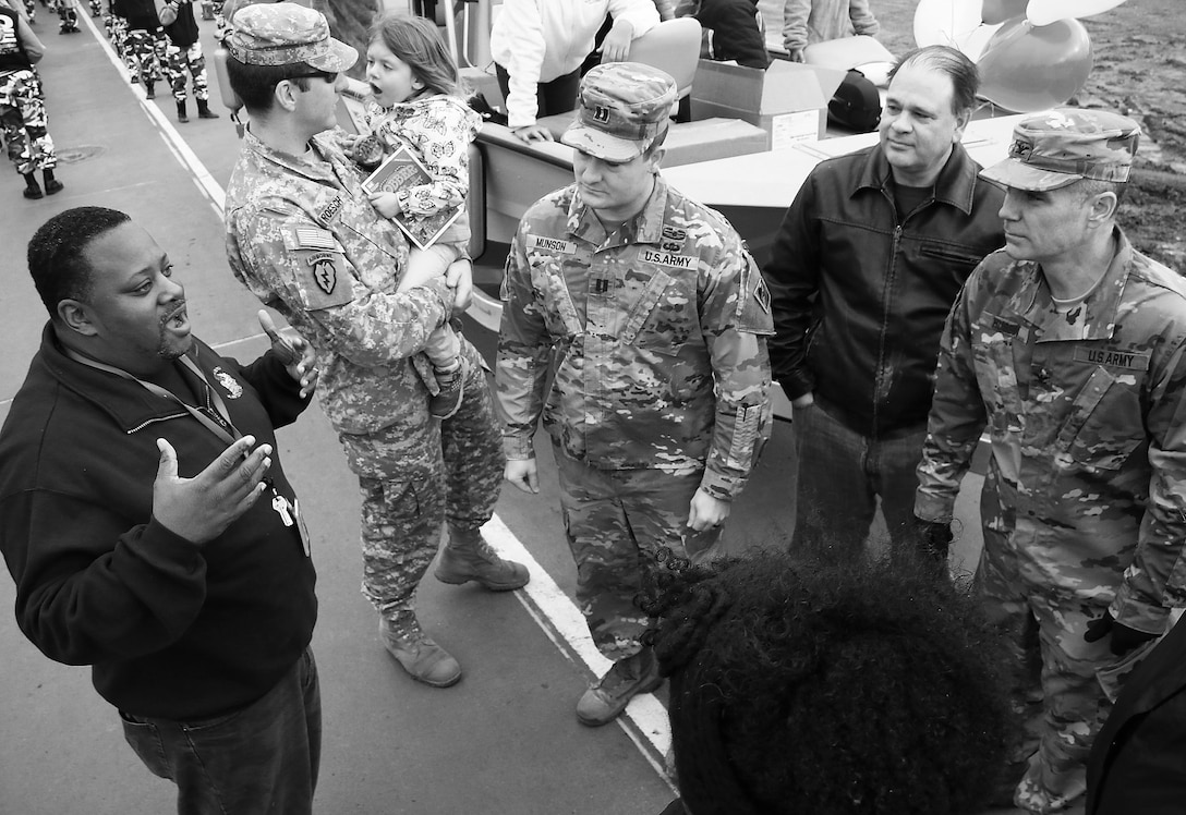 Colonel Christopher Hussin, commander, Tulsa District, U.S. Army Corps of Engineers, and district volunteers receive parade instructions from Mr. Michael Ware, African American Programs Manager,  before the beginnning of the 38th annual Martin Luther King Jr. Commemorative Parade in Tulsa, Okla., January 16, 2017.   Personnel from the Tulsa District have been participating in the city of Tulsa's MLK Day parade for more than 20 years. (U.S. Army Corps of Engineers photo by Preston Chasteen/Released)