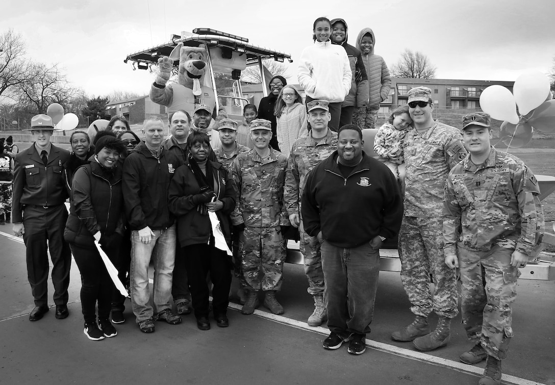 Colonel Christopher Hussin, commander, Tulsa District, U.S. Army Corps of Engineers, and staff volunteers gather around their entry vehicle for the 38th annual Martin Luther King Jr. Commemorative Parade in Tulsa, Okla., January 16, 2017.   Personnel from the Tulsa District have been participating in the city of Tulsa's MLK Day parade for more than 20 years. (U.S. Army Corps of Engineers photo by Preston Chasteen/Released)