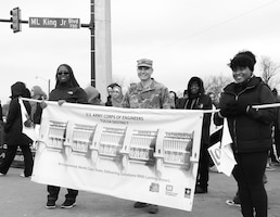 Colonel Christopher Hussin, commander, Tulsa District, U.S. Army Corps of Engineers, and Mrs. Rhonda Leal, left, Equal Employment Opportunity Specialist, along with Ms. Jennifer Stewart, right, Architect, stand on Martin Luther King Jr. Boulevard in preparation to begin marching in the 38th annual Martin Luther King Jr. Commemorative Parade in Tulsa, Okla., January 16, 2017.   Personnel from the Tulsa District have been participating in the city of Tulsa's MLK Day parade for more than 20 years. (U.S. Army Corps of Engineers photo by Preston Chasteen/Released)