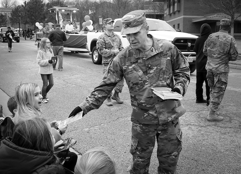 Colonel Christopher Hussin, commander, Tulsa District, U.S. Army Corps of Engineers, passes out coloring books as water safety reminders to children along the parade route during the 38th annual Martin Luther King Jr. Commemorative Parade in Tulsa, Okla., January 16, 2017.   Personnel from the Tulsa District have been participating in the city of Tulsa's MLK Day parade for more than 20 years. (U.S. Army Corps of Engineers photo by Preston Chasteen/Released)