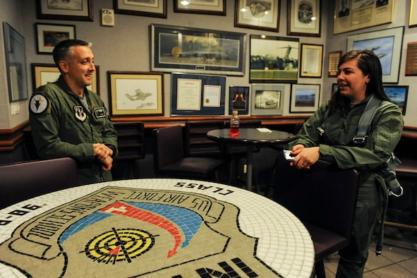 Capt. Josh Hovanas, 433rd Weapons Squadron F-15 Eagle pilot, speaks with Senior Airman Sierra Elliott, 57th Maintenance Squadron munitions specialist, before an incentive flight at Nellis Air Force Base, Nev., Jan. 6, 2017. Elliott was one of 29 Airmen assigned to the 57th Wing who received incentive flights in an F-15 Eagle, F-15E Strike Eagle or F-16 Fighting Falcon during the wing's annual incentive fly day.