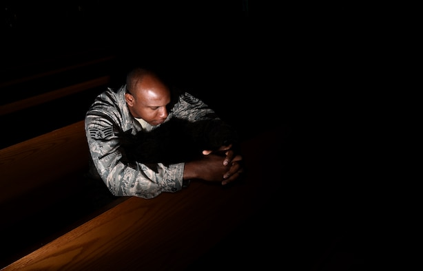 Staff Sgt. Anthony Bean, 21st Space Wing chaplain assistant, takes time during his day to pray in the sanctuary of the Base Chapel at Peterson Air Force Base, Colorado, Aug. 8, 2016. (U.S. Air Force photo by Airman 1st Class Dennis Hoffman)