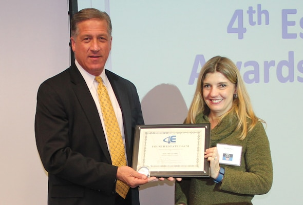 Defense Acquisition Career Manager Robert Daugherty presents DLA's Joy Mullori the inaugural DACM Chairman's Award, Jan. 10, 2017, Fort Belvoir, Virginia.