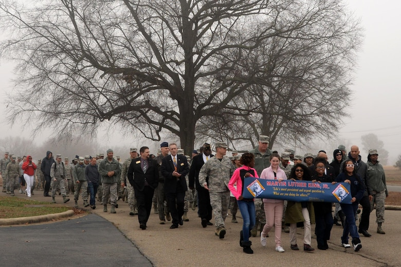Team Little Rock members march in unity to remember Martin Luther King Jr. January 13, 2017, at Little Rock Air Force Base, Ark. The event began at the Herk Hall on base and participants marched to the nearby Walters Community Support Center. (U.S. Air Force photo by Airman 1st Class Codie Collins)