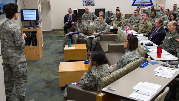 Maj. Crystal Karahan, 59th Medical Wing Gateway Academy chief, shares information about the wing's Gateway Academy during a briefing at the Wilford Hall Ambulatory Surgical Center, Joint Base San Antonio-Lackland, Texas, Jan. 11. The academy provides instruction on innovative problem solving techniques, inspires people to challenge the status quo, and teaches leadership skills that foster empowerment, trust and respect. (U.S. Air Force photo/Staff Sgt. Kevin Iinuma)