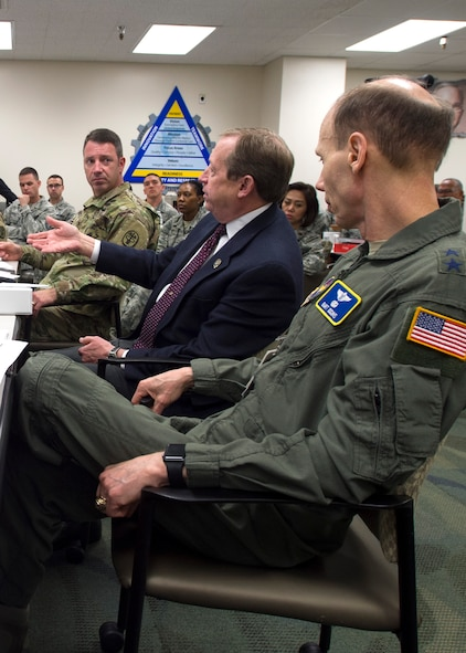 Maj. Gen. Bart Iddins (right), 59th Medical Wing commander, and Army Col. Damon Baine (left), San Antonio Military Health System chief operating officer, listen to Dr. Brent James offer input during a briefing at the Gateway Academy in the Wilford Hall Ambulatory Surgical Center, Joint Base San Antonio-Lackland, Texas, Jan. 11. An internationally known expert in the field of clinical quality improvement, James shared lessons learned from previous job encounters from the past 30 years. He is executive director of the Institute for Health Care Delivery Research and vice president, Medical Research and Continuing Medical Education at Intermountain Healthcare in Salt Lake City, Utah. (U.S. Air Force photo/Staff Sgt. Kevin Iinuma)
