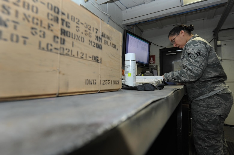 U.S. Air Force Senior Airman Angela Barbour, 19th Maintenance Squadron inspector technician, reviews a checklist before inspecting an ammunition crate for distribution Dec. 14, 2016, at Little Rock Air Force Base, Ark. The munitions flight members complete a variety of different tasks ranging from storing ammunition to inspecting munitions. (U.S. Air Force photo by Airman 1st Class Grace Nichols)