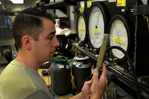 U.S. Air Force Staff Sgt. Joseph Gerdes, 20th Component Maintenance Squadron precision measurement equipment laboratory craftsman, compares the readings of two gauges at Shaw Air Force Base, S.C., Dec. 22, 2016. PMEL Airmen use gauges from their shop to test other equipment for accuracy. (U.S. Air Force photo by Airman 1st Class Destinee Sweeney)