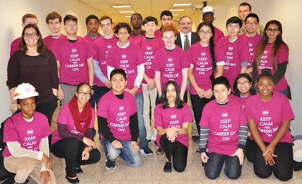 "Students from New York City high schools sport T-shirts emblazoned with the slogan, ""Keep Calm and Career Day On"" as part of STEM (science, technology, engineering and math) Career Day where they learned about science and engineering careers from professionals in the field. District personnel Kara Borzillo (left) and Mike Rovi (in jacket and tie) gave interactive presentations. (Photo: James D'Ambrosio, Public Affairs Specialist)."