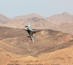 A French Airman operating a Force Mirage 2000B fixed-wing aircraft conducts a show of force at AS-01 Range complex in Djibouti, Africa, Oct. 18, 2016. The training, conducted between U.S. Marines with Special Purpose Marine Air Ground Task Force-Crisis Response-Africa and French Fighter Squadron 3/11, was intended to establish bilateral standard operating procedures and strengthen international working relationships. (U.S. Marine Corps photo by Staff Sgt. David L. Proffitt)
