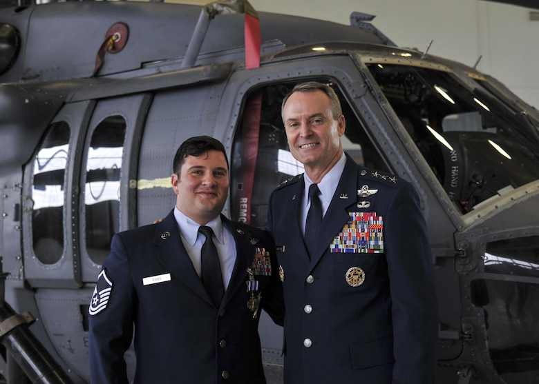 Master Sgt. Gregory Gibbs, 512th Rescue Squadron operations superintendent, right, and Lt. Gen. Darryl Roberson, Air Education and Training Command commander, from Joint Base San Antonio, Texas, stand in front of an HH-60 Pave Hawk following the Distinguished Flying Cross medal ceremony at Kirtland Air Force Base, New Mexico, Jan. 13. Ranked as the highest military aviation award, Gibbs received the medal for distinguishing himself as a HH-60 Pave Hawk aerial gunner in a high-risk rescue mission in Afghanistan on May 26, 2011.