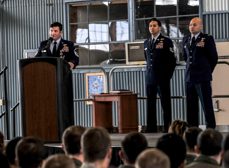 Master Sgt. Gregory Gibbs, 512th Rescue Squadron operations superintendent, addresses the audience during the Distinguished Flying Cross medal presentation at Kirtland Air Force Base, New Mexico, Jan. 13. Gibbs and his team rescued three soldiers from an active minefield at the Pakistani border. Gibbs attributed the success of the mission to basic fundamentals that he learned while in training on Kirtland.