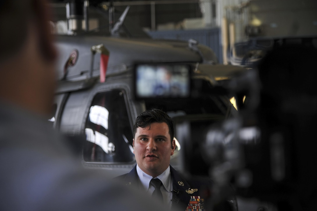 Master Sgt. Gregory Gibbs, 512th Rescue Squadron operations superintendent, interviews with local media outlets during the Distinguished Flying Cross medal ceremony at Kirtland Air Force Base, New Mexico, Jan. 13. Gibbs received the medal for his quick decision making that saved the lives of nine personnel during a 2011 tour of Afghanistan. (U.S. Air Force photo by Senior Airman Nigel Sandridge)