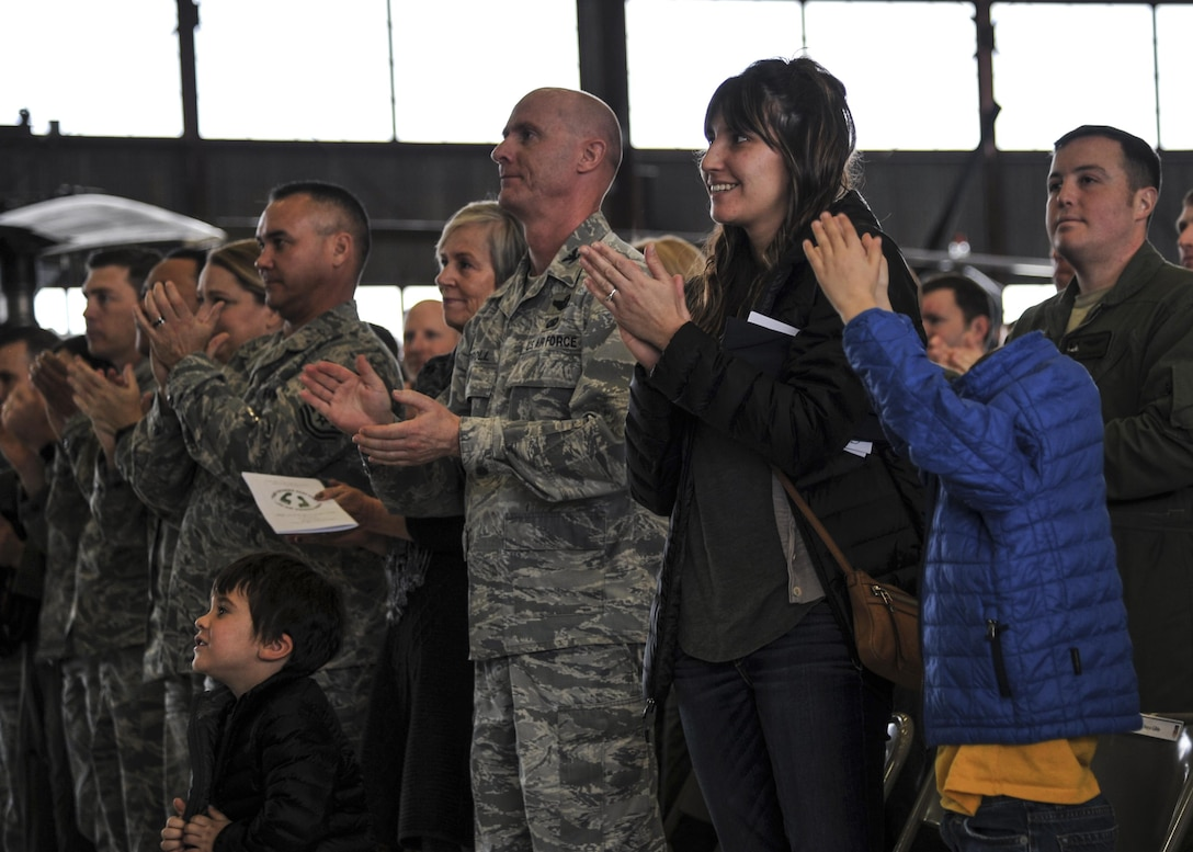 Family and friends applaud during the Distinguished Flying Cross medal ceremony at Kirtland Air Force Base, New Mexico, Jan. 13. The medal was awarded to MSgt. Gregory Gibbs, 512th Rescue Squadron operations superintendent, whose split decision making skills during a 2011 rescue mission in Afghanistan saved not only the three soldiers trapped, but the crew flying Pedro 55. (U.S. Air Force photo by Senior Airman Nigel Sandridge)