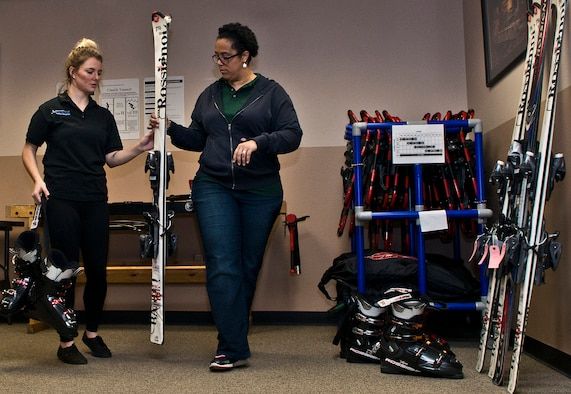 (From left) Ashley Shafer, 5th Force Support Squadron Outdoor Recreation aid, and Dana Sharrit, 5 FSS Outdoor Recreation associate, finish calibrating skis at Minot Air Force Base, N.D., Dec. 2, 2016. Outdoor Rec. is an organization that gives Airmen and their families the opportunity to experience North Dakota events like skiing, snowboarding and dog sledding. (U.S. Air Force photo/Airman 1st Class Jonathan McElderry)