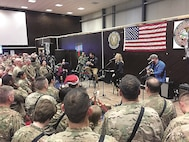 Kellie Pickler, an American country music artist, performs for deployed service members during a USO Christmas Eve show Dec. 24, 2016 in Baghdad, Iraq. Pickler who has travelled 11 times with USO, headlined the event. Pickler, accompanied by her husband, Kyle Jacobs, performed a medley of holiday songs and a few of her own songs.  Capt. Jessica Deason, a human resources plans and operations officer for Combined Joint Forces Land Component Command – Operation Inherent Resolve, brought Pickler and her husband, guitarist Kyle Jacobs, along with chef Robert Irvine, his wife, wrestler Gail Kim, and New York Friars Club Roastmaster General Jeff Ross to the base to perform for the holidays.