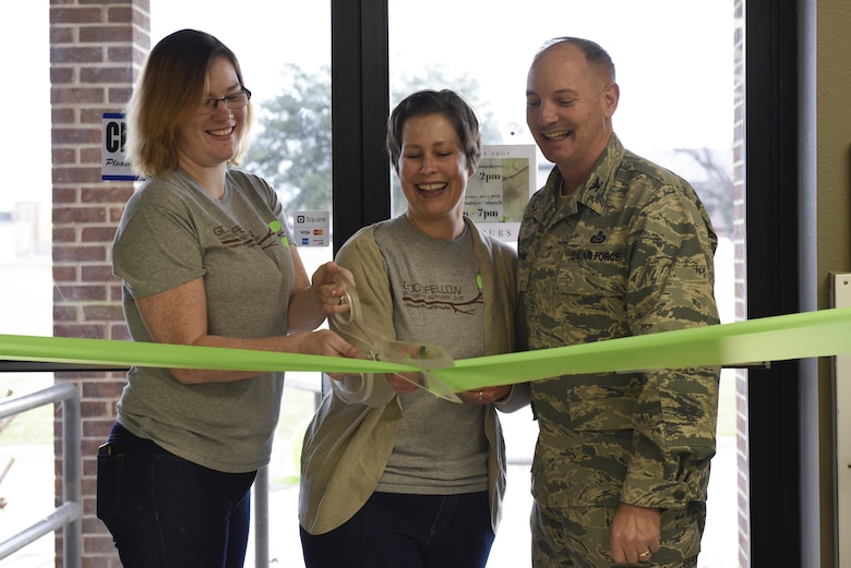 U.S. Air Force Col. Michael Downs, 17th Training Wing Commander, and Goodfellow combined spouses club members cut the grand re-opening ribbon for the Goodfellow Combined Spouses Club Thrift Shop, Jan. 17, 2017. The thrift shop re-opened due to increased base interest and participation. (U.S. Air Force photo by Airman 1st Class Chase Sousa/Released)