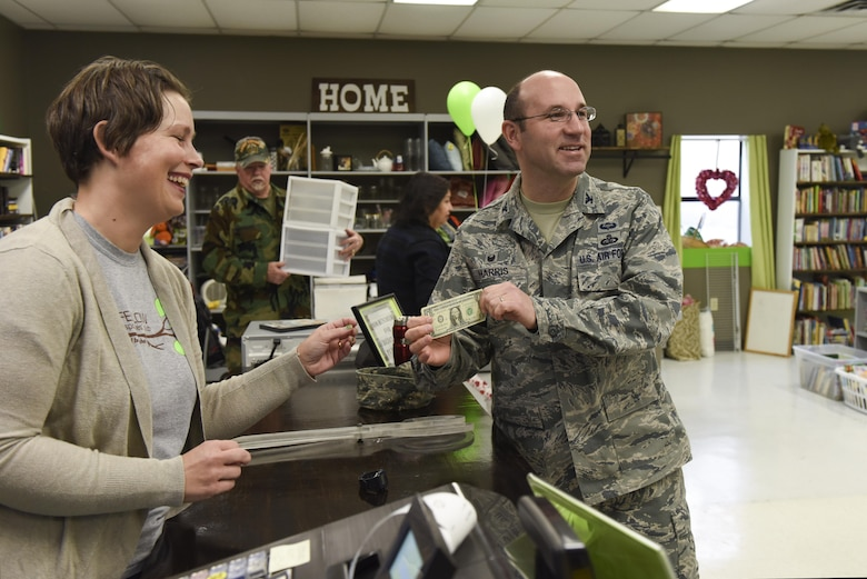 U.S. Air Force Col. Christopher Harris, 17th Mission Support Group Commander, buys an item at the Goodfellow Combined Spouses Club Thrift Shop Jan. 17, 2017. Harris is the first sale of the thrift shop since its re-opening. (U.S. Air Force photo by Airman 1st Class Chase Sousa/Released)