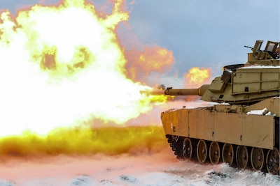 Soldiers fire a live round from an M1A2 battle tank during an accuracy test in Swietozow, Poland, Jan. 16, 2017. The soldiers are assigned to the 4th Infantry Division's 1st Battalion, 68th Armor Regiment, 3rd Armored Brigade Combat Team. The unit's arrival marks the start of rotations of armored brigades in Europe. This rotation will enhance deterrence capabilities in the region, improve the U.S. ability to respond to potential crises, and defend allies and partners in the European community. Army photo by Staff Sgt. Micah VanDyke