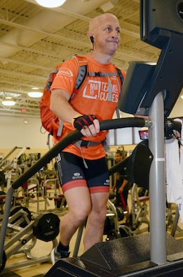 U.S. Air Force Lt. Col. retired Gary Rudman, United States Air Forces Central Command Safety deputy director, climbs a stair machine at Shaw Air Force Base, S.C., Dec. 14, 2016. Rudman is conditioning his body to prepare for his climb in February to Mount Kilimanjaro, Tanzania. (U.S. Air Force photo by Tech. Sgt. Jim Araos/Released)