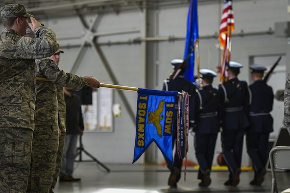 Air Commandos with the 1st Special Operations Aircraft Maintenance Squadron salute during the presentation of the colors at an assumption of command ceremony on Hurlburt Field, Fla., Jan. 12, 2017. The 1st SOAMXS is responsible for maintenance on the AC-130U Spooky gunships. (U.S. Air Force photo by Airman 1st Class Joseph Pick)