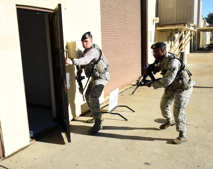 9th Security Forces Squadron Airmen enter a building during an active shooter exercise after arriving on scene Jan. 13, 2017 at Beale Air Force Base, California. The exercise took place in a building on the flightline and began at approximately 10 a.m. (U.S. Air Force photo/John Schwab)