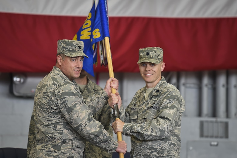 Col. Harry Seibert, left, commander of the 1st Special Operations Maintenance Group, presents Lt. Col. Philip Broyles, commander of the 1st Special Operations Aircraft Maintenance Squadron, with the 1st SOAMXS guidon during an assumption of command ceremony at Hurlburt Field, Fla., Jan. 12, 2017. Broyles previously served as the commander of the 801st Special Operations Aircraft Maintenance Squadron. (U.S. Air Force photo by Airman 1st Class Joseph Pick)