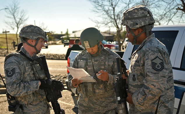 First responders plan the apprehension of the suspect and the recovery of the injured during an active shooter exercise Jan. 13, 2017 at Beale Air Force Base, Calif. Exercises help prepare Airmen for real world scenarios. (U.S. Air Force photo/Airman Tristan D. Viglianco)