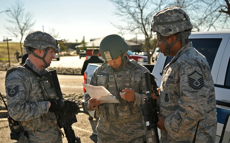 First responders plan the apprehension of the suspect and the recovery of the injured during an active shooter exercise Jan. 13, 2017 at Beale Air Force Base, California. Exercises help prepare Airmen for real world scenarios. (U.S. Air Force photo/Airman Tristan D. Viglianco)