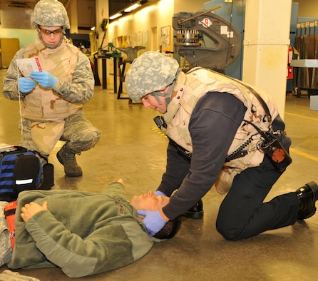 First responders assess and treat a wounded Airman during an active shooter exercise Jan. 13, 2017 at Beale Air Force Base, Calif. The first responders began treating the victims once the building was secured by the 9th Security Forces Squadron. (U.S. Air Force photo/Airman Tristan D. Viglianco)