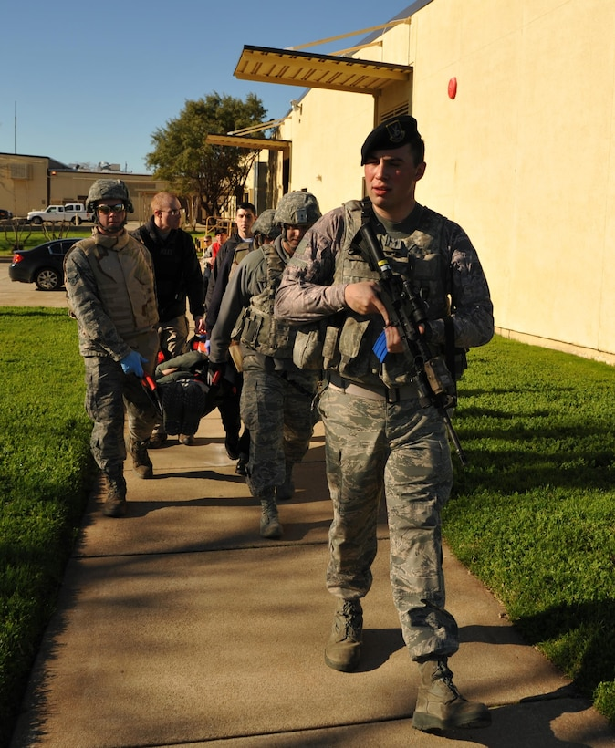 9th Security Forces personnel and first responders evacuate a wounded Airman during an active shooter exercise Jan. 13, 2017 at Beale Air Force Base, California. The exercise helped prepare units on base in the case of a real-world scenario. (U.S. Air Force photo/Airman Tristan D. Viglianco)