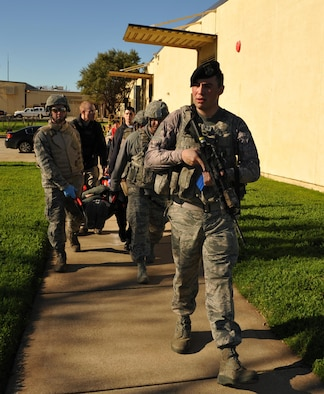 9th Security Forces personnel and first responders evacuate a wounded Airman during an active shooter exercise Jan. 13, 2017 at Beale Air Force Base, Calif. The exercise helped prepare units on base in the case of a real-world scenario. (U.S. Air Force photo/Airman Tristan D. Viglianco)