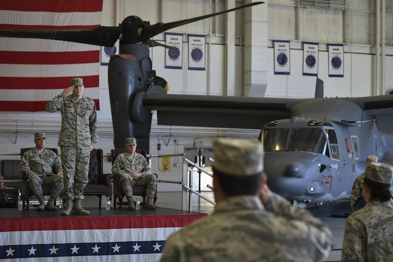 Air Commandos with the 801st Special Operations Aircraft Maintenance Squadron render their first salute to Maj. Bryan Hogan, commander of the 801st SOAMXS, during a change of command ceremony at Hurlburt Field, Fla., Jan. 12, 2017. Hogan took command of the 801st SOAMXS from outgoing commander, Lt. Col. Philip Broyles. (U.S. Air Force photo by Airman 1st Class Joseph Pick)