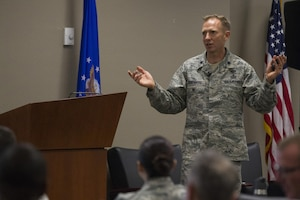 """Lt. Col. Trevor Rosenberg, Profession of Arms Center of Excellence instructor, teaches """"Professionalism: Enhancing Human Capital"""" on Nov. 29, 2016, at March Air Reserve Base, California. The day-long course focuses on self-reflection as pathway to becoming better in all aspects of personal and professional life. (Air National Guard photo by Airman 1st Class Crystal Housman)"""