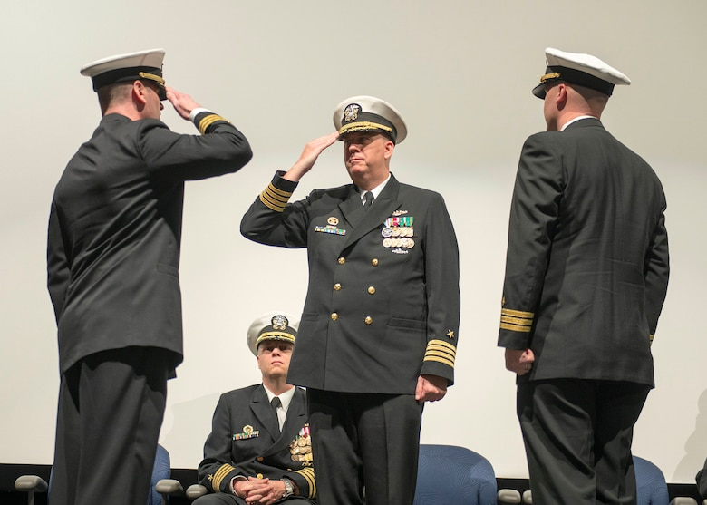 KEYPORT, Wash. (Jan. 13, 2017) Cmdr. John Cage, from Jefferson City, Missouri, left, requests to be relieved of command by Capt. Mark Schmall, Commander, Submarine Squadron 17, center, during a change of command ceremony for the Blue Crew of the Ohio-class ballistic-missile submarine USS Pennsylvania (SSBN 735). During the ceremony, held at the Keyport Undersea Museum, Cage turned over command to Cmdr. Steven Everhart, from Great Falls, Montana. (U.S. Navy photo by Mass Communication Specialist 1st Class Amanda R. Gray/Released)