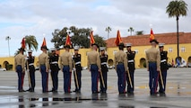 The honormen of Fox Company, 2nd Recruit Training Battalion, return the guidons to their drill instructors during the graduation ceremony at Marine Corps Recruit Depot San Diego, Jan. 13. These guidons have been carried by the platoon guides for the duration of training, and this portion of the ceremony marks the disbanding of the platoons. Annually, more than 17,000 males recruited from the Western Recruiting Region are trained at MCRD San Diego.